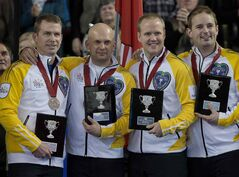Manitoba's Jeff Stoughton, Jon Mead, Mark Nichols and Reid Carruthers, left to right, display their awards after winning the bronze medal at the Tim Hortons Brier in Kamloops, B.C. on March 9.