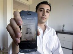 David Sierra, sits in his family owned realty company in Coral Gables, Fla., Tuesday, Jan. 29, 2013, displaying an image on his cellphone showing a flier that the management company passed out to tenants in an office complex where they rented space to Biogenesis and Anthony Bosch. New York Yankees' Alex Rodriguez has denied a newspaper report on Tuesday that accused the baseball star of buying human growth hormone and other performance-enhancing substances from a clinic in the Miami area. The Miami New Times, an alternative weekly, reported that it obtained records detailing purchases by Rodriguez, Melky Cabrera, Gio Gonzalez, Bartolo Colon, Nelson Cruz and Yasmani Grandal from a clinic called Biogenesis, run by Bosch. (AP Photo/J Pat Carter)