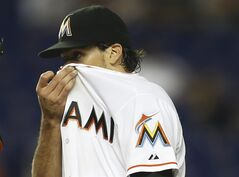 Miami Marlins starter Nathan Eovaldi pauses during a mound conference as he pitches during the first inning of a baseball game against the Pittsburgh Pirates in Miami, Friday, June 13, 2014. (AP Photo/J Pat Carter)