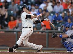 San Francisco Giants' Buster Posey hits into a double play during the first inning of a baseball game against the Los Angeles Dodgers, Saturday, July 26, 2014, in San Francisco. (AP Photo/Beck Diefenbach)