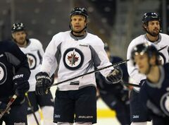 Winnipeg Jets Olli Jokinen, centre, with teammates during practice Monday morning at the MTS Centre. The Jets are prepping for a home game Tuesday against the Buffalo Sabres.