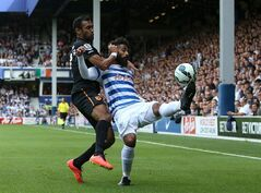 Queens Park Rangers' Armand Traore, right, battles for possession of the ball with Hull City's Ahmed Elmohamady during their English Premier League soccer match at Loftus Road, London, Saturday, Aug. 16, 2014. (AP Photo/John Walton, PA Wire) UNITED KINGDOM OUT - NO SALES - NO ARCHIVES