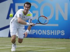 British Andy Murray in action against Paul-Henri Mathieu of France during the Aegon Championships tennis tournament at The Queen's Club in London, Wednesday June 11, 2014. (AP Photo / Jonathan Brady, PA) UNITED KINGDOM OUT - NO SALES - NO ARCHIVES