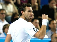 Ernests Gulbis of Latvia raises his fist after winning a point against France's Jo-Wilfried Tsonga , during their final match, at the Open 13 tennis tournament, in Marseille, southern France, Sunday, Feb. 23 , 2014. (AP Photo/Claude Paris)