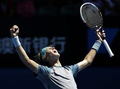 Alexander Zvere celebrates after winning the Australian Open boy's tennis championship against Stefan Kozlov of the U.S. in Melbourne, Australia, Saturday, Jan. 25, 2014. (AP Photo/Aijaz Rahi)