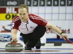 Newfoundland/Labrador third Mark Nichols throws a rock while playing against Ontario during the Brier Canadian Curling Championships in London, Ont.