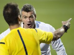 Toronto FC head coach Ryan Nelsen argues a call an official while playing against the Sporting Kansas City during second half MLS soccer action in Toronto on Saturday, July 26, 2014. Nelsen said Toronto FC has moved on from its 2-1 loss to Sporting KC over the weekend, but the state of officiating in Major League Soccer still seems to be weighing on the mind of the head coach. THE CANADIAN PRESS/Nathan Denette