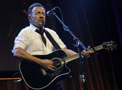 """FILE - In this Thursday, May 8, 2014, file photo, Bruce Springsteen performs during the USC Shoah Foundation's 20th anniversary Ambassadors for Humanity gala in Los Angeles. Springsteen is getting into the picture book business. """"Outlaw Pete,"""" based on a ballad from Springsteen's """"Working on a Dream"""" album, will be published by Simon & Schuster on Nov. 4, 2014. The book will feature Springsteen's lyrics and illustrations by Frank Caruso, Simon & Schuster announced Thursday, Aug. 28. (AP Photo/Susan Walsh, File)"""