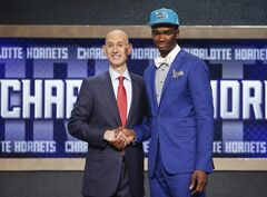 Indiana's Noah Vonleh, right, poses for a photo with NBA Commissioner Adam Silver after being selected ninth overall by the Charlotte Hornets during the 2014 NBA draft, Thursday, June 26, 2014, in New York. (AP Photo/Jason DeCrow)