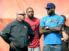 Cleveland Cavaliers' LeBron James, right, talks with Cleveland Browns head coach Mike Pettine at the Browns training camp in Berea, Ohio, Thursday, Aug. 7, 2014. (AP Photo/The Cleveland Plaindealer, Chuck Crow) NO SALES MANDATORY CREDIT TV OUT ONLINE OUT
