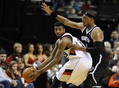 Brooklyn Nets' Paul Pierce (34) defends against Portland Trail Blazers' Dorell Wright (1) during the first half of an NBA basketball game in Portland, Ore., Wednesday, Feb. 26, 2014. (AP Photo/Greg Wahl-Stephens)