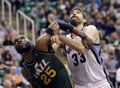 Utah Jazz's Al Jefferson (25) and Memphis Grizzlies' Marc Gasol (33) battle under the boards in the second quarter of an NBA basketball game, Saturday, March 16, 2013, in Salt Lake City. (AP Photo/Rick Bowmer)