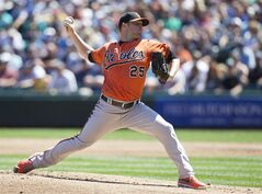 Baltimore Orioles starter Bud Norris delivers a pitch during the first inning of a baseball game against the Seattle Mariners in Seattle, Saturday, July 26, 2014. (AP Photo/Stephen Brashear)