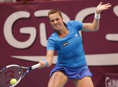 Anastasia Pavlyuchenkova of Russia returns the ball to Maria Sharapova of Russia during the semifinal match of the 22st Gaz de France WTA Open 2014 tennis tournament at Coubertin stadium, in Paris, Saturday, Feb. 1, 2014. (AP Photo/Jacques Brinon)