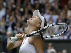 Agnieszka Radwanska of Poland reacts as she wins a semifinals match against Angelique Kerber of Germany at the All England Lawn Tennis Championships at Wimbledon, England, Thursday, July 5, 2012. (AP Photo/Anja Niedringhaus)