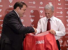Canadian Soccer Association president Victor Montagliani, left, congradulates former Real Madrid manager Benito Floro as he is introduced Friday, July 5, 2013 in Toronto as coach of the Canadian men's national team. THE CANADIAN PRESS/Neil Davidson