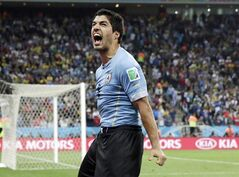 FILE - This is a Thursday, June 19, 2014 file photo of Uruguay's Luis Suarez as he celebrates after scoring his side's second goal during the group D World Cup soccer match between Uruguay and England at the Itaquerao Stadium in Sao Paulo, Brazil. The Court of Arbitration for Sport on Thursday Aug. 14, 2014 upheld Luis Suarez's four-month ban for biting an opponent at the World Cup, but cleared him to train with Barcelona. (AP Photo/Matt Dunham, File)