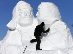 David MacNair works on Woven Together, a sculpture celebrating the 45 year history of the Festival du Voyageur.