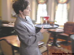 Michele Wood relies on her daytime bartending job at the Fort Garry Hotel for a steady income while pursuing a second career as a singer on the side.