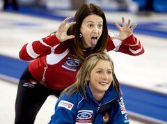 Canada skip Heather Nedohin hams it up behind Scotland skip Eve Muirhead at a practice session Friday in Lethbridge.
