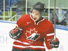 Team Canada forward Ty Rattie celebrates after scoring on Slovakia during the second period on Friday.