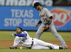 Texas Rangers' Elvis Andrus lays on the ground after being called out looking up at second base umpire Clint Fagan, not pictured, as Detroit Tigers shortstop Eugenio Suarez (30) searches for the ball in the first inning of a baseball game, Tuesday, June 24, 2014, in Arlington, Texas. Andrus was caught in a run down attempting to steal second on the play. (AP Photo/Tony Gutierrez)