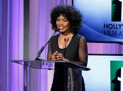 FILE - In this Oct. 21, 2013 file photo, actress Angela Bassett speaks on stage at the 17th Annual Hollywood Film Awards Gala at the Beverly Hilton Hotel in Beverly Hills, Calif. The Lifetime TV channel says it will air a movie about the relationship of Whitney Houston and Bobby Brown, with Bassett set to direct. The channel said Thursday, May 22, 2014, the movie will follow the couple through their first meeting and tumultuous marriage and Houston's rise to fame. (Photo by Todd Williamson/Invision/AP, file)