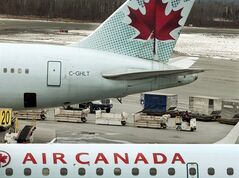An Air Canada aircraft is unloaded at the Halifax Stanfield International Airport in Enfield, N.S. on Wednesday, March 7, 2012. Air Canada says it has cancelled a scheduled flight from Toronto to Tel Aviv tonight following reports of a rocket explosion near the Israeli city's airport. THE CANADIAN PRESS/Andrew Vaughan
