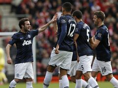 Manchester United's Juan Mata, left, celebrates his goal against Southampton with teammates during their English Premier League soccer match at St Mary's stadium, Southampton, England, Sunday, May 11, 2014. (AP Photo/Sang Tan)