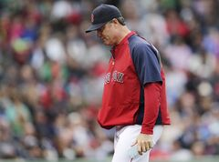 Boston Red Sox manager John Farrell heads back to the dugout after removing starter Jon Lester during the seventh inning against the Toronto Blue Jays in a baseball game at Fenway Park, Thursday, May 22, 2014, in Boston. Lester gave up seven runs on 10 hits in the Red Sox's 7-2 loss, the team's seventh straight loss at home. (AP Photo/Charles Krupa)