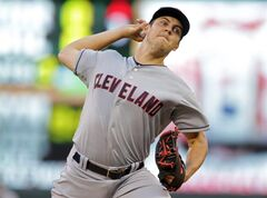 Cleveland Indians pitcher Trevor Bauer throws against the Minnesota Twins in the first inning of a baseball game, Tuesday, Aug. 19, 2014, in Minneapolis. (AP Photo/Jim Mone)