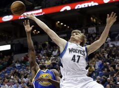 Minnesota Timberwolves' Andrei Kirilenko of Russia, right, loses the ball on a layup attempt as he is fouled by Golden State Warriors' Harrison Barnes in the first quarter of an NBA basketball game Sunday, Feb. 24, 2013, in Minneapolis. (AP Photo/Jim Mone)