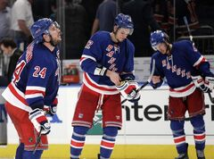 New York Rangers' Ryan Callahan (24), Artem Anisimov (42) and Michael Del Zotto (4) leave the ice after Game 2 of the NHL hockey Stanley Cup Eastern Conference final playoff series against the New Jersey Devils, Wednesday, May 16, 2012, in New York. The Devils won 3-2.