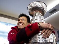 Canadian Olympic silver medalist figure skater Patrick Chan hugs the Stanley Cup at Canada House at the 2014 Sochi Winter Olympics in Sochi, Russia on Monday, February 17, 2014. THE CANADIAN PRESS/Nathan Denette