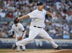 New York Yankees pitcher Vidal Nuno delivers against the Boston Red Sox in the second inning of a baseball game, Friday, June 27, 2014, in New York. (AP Photo/Julie Jacobson)