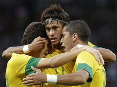 Brazil's Romulo, right, celebrates his goal with his teammates Neymar, center, and Oscar, left, during the men's semifinal soccer match between Brazil and South Korea at the 2012 London Summer Olympics, in Manchester, England, Tuesday, Aug. 7, 2012. (AP Photo/Hussein Malla)
