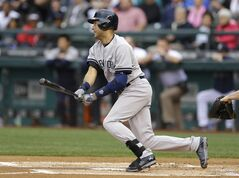 New York Yankees' Derek Jeter hits a single in the first inning of a baseball game against the Seattle Mariners, Tuesday, June 10, 2014, in Seattle. (AP Photo/Ted S. Warren)