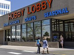FILE - In this May 22, 2013, customers enter and exit a Hobby Lobby store in Denver. The Supreme Court is poised to deliver its verdict in a case that weighs the religious rights of employers and the right of women to the birth control of their choice. Employers must cover contraception for women at no extra charge among a range of preventive benefits in employee health plans. Dozens of companies, including the arts and crafts chain Hobby Lobby, claim religious objections to covering some or all contraceptives. (AP Photo/Ed Andrieski, File)