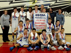 The Oak Park Raiders junior varsity boys celebrate their provincial championship after defeating St. Paul's in the final.
