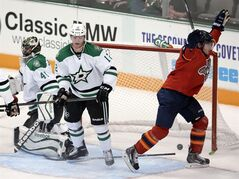 Florida Panthers' Scottie Upshall, right, celebrates his goal as Dallas Stars' Cris Nilstorp (41), of Sweden, and Alex Chiasson (12) look on in the third period of a preseason NHL hockey game on Wednesday, Sept. 18, 2013, in Dallas. (AP Photo/Tony Gutierrez)