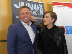 Juno Awards hosts Johnny Reid and Serena Ryder shrugged off an online petition to remove Robin Thicke from the lineup of Sunday's broadcast.