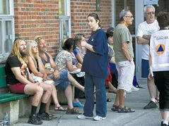 Residents wait outside an emergency centre for news of family and friends.