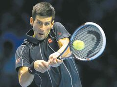 Novak Djokovic returns a Rafael Nadal serve in the final Monday.