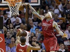 Atlanta Hawks' Shelvin Mack, left, shoots as Miami Heat's Chris Andersen (11) deflects the ball in the first half of an NBA basketball game, Monday, Dec. 23, 2013, in Miami. (AP Photo/Lynne Sladky)