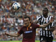 Roma defender Vasilis Torosidis, of Greece, left, and Juventus midfielder Paul Pogba, of France, vie for the ball during an Italian Serie A soccer match between Roma and Juventus at Rome's Olympic stadium, Sunday, May 11, 2014. (AP Photo/Alessandra Tarantino)