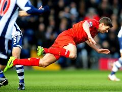 Liverpool's Steven Gerrard falls after a tackle during the English Premier League soccer match against West Bromwich Albion at The Hawthorns stadium in West Bromwich, England, Sunday, Feb. 2, 2014. (AP Photo/Rui Vieira)