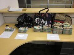 Cash and goods seized from two police raids on Valentine's Day in Winnipeg.