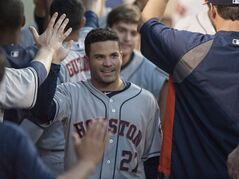 Houston Astros' Jose Altuve is being greeted by his teammates after he scored in the third inning of a baseball game against the Los Angeles Angels Thursday, July 3, 2014, in Anaheim, Calif. (AP Photo/The Orange County Register, Kyusung Gong) MAGS OUT; LOS ANGELES TIMES OUT