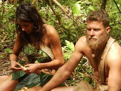 In this photo provided by the Discovery Channel, Jaclyn, left, and Adam eat mandarins while sitting down in a scene from the TV series,