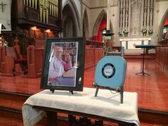 A 3/4 inch videocassette case containing the ashes of former CBC anchor Knowlton Nash sits beside his portrait at his funeral in Toronto on Wednesday, May 28, 2014. THE CANADIAN PRESS/CBC - Ioanna Roumeliotis